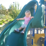 Keaton does the slide all by herself, like a big girl